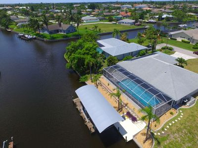 Photo for SE Cape Coral Pool Home on Gulf Access Canal - Screened Lanai w/ Gas BBQ, Beach Gear Provided, Wifi