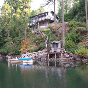 A view of the cottage and private dock from the water