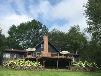 Front view of Cabin. Two tiered deck and blooming hydrangeas. Mountain Views.