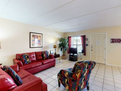 Photo for Family-friendly condo w/ patio & sparkling shared pool - steps to beach!