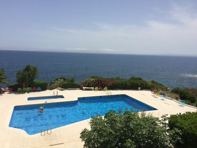 Photo for DELFINROSAS7 sea view and pool view + private access to the sea + terrace and parking