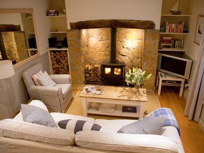 Photo for Ideal Dorset holiday cottage perfect for beach walks, pub lunches & log fires.