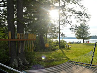 Photo for Lake front sandy beach facing fantastic sunsets!!