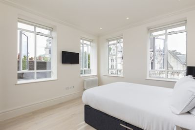 Bright bedroom with a queen size bed