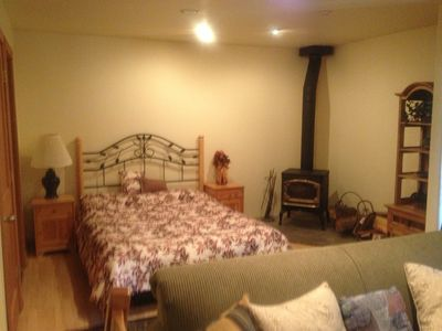 Queen size bed and wood stove