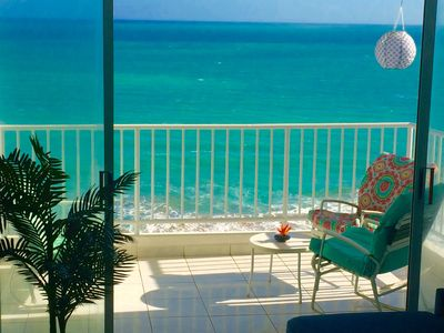 Enjoy the surf on your private balcony right on the beach!