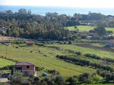 Photo for A cozy vacation property lain at 1300 meters from the Beach Museddu.