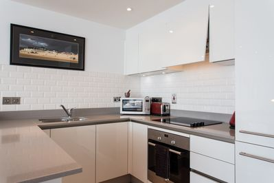 Fully-equipped kitchen with dishwasher, wine chiller, microwave, breakfast bar