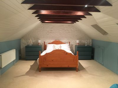 Large master en suite with exposed beams