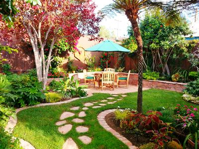 Backyard with Teak Dining Table and Flagstone Patio