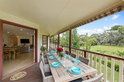 Outdoor decking area with large table and chairs