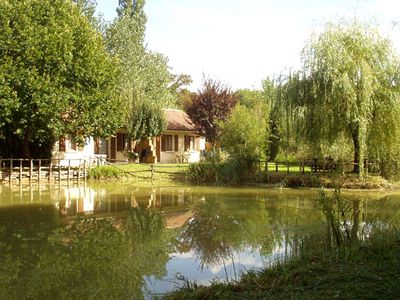 Photo for SARLAT DORDOGNE 4 HOUSES WITH HEATED POOL AND LAKE FOR FISHING