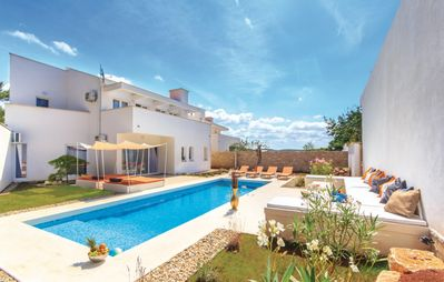 Photo for Modern villa with pool; group & big family friendly; maximum 12 people