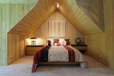 Spacious second level Queen size bedroom with soft wood for calm relaxing eves.