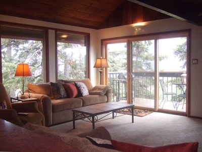 Large windows frame the incredible views from the living area and kitchen.