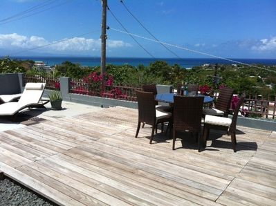 Sun Deck lounge for sunbathing, cocktails with views of ocean and mountains