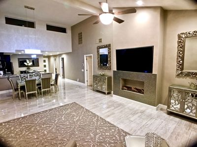 """Huge living room is open to the dining area & kitchen. Has fireplace & 70"""" TV"""