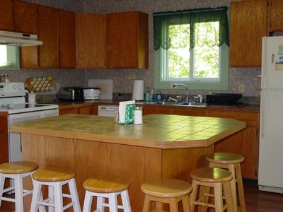 Apt B Downstairs has a large, outfitted kitchen with DW and large island bar