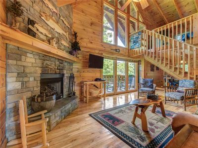 """Rustic touches, modern amenities - As well as a charming gas fireplace with a stone surround—just the thing for chilly winter evenings—the living room has a 51"""" TV with cable and a DVD player. The house has internet access too."""