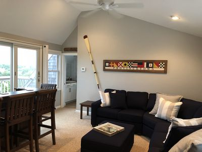 3rd fl entertainment space w/sectional, bar, full bath, and deck with views!