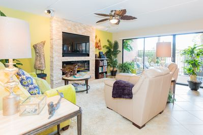 Beautiful open concept with gorgeous view of patio and palms.