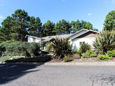 Photo for Private home w/ wooded views, back yard, & deck - one block to the ocean!