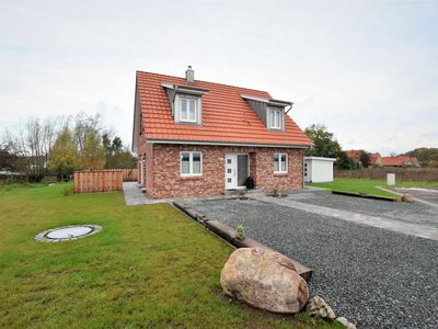 Photo for New holiday home with terrace, sauna and a fireplace