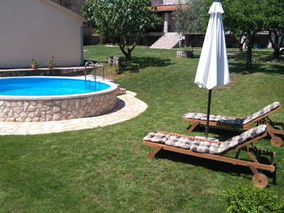 Photo for Comfortable family home with pool and garden, covered grill and dining area