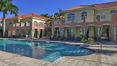 Photo for Penthouse Suite, Luxurious Poolside Retreat in Palm Beach Gardens, Florida