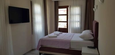 Photo for Sezgin Boutique Hotel DoubleRoom A/C,TV,fridge,pool,garden,free wi-fi & car park