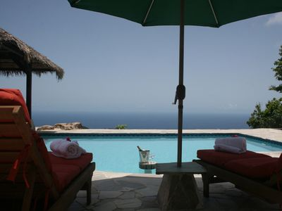 Pooldeck with gazebo and amazing view over the Caribbean Sea.