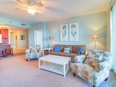 Photo for Waterfront condo w/ 5 shared pools, hot tub & views - walk to the beach!