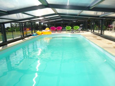 Photo for charming cottage in a quiet and green setting, heated pool