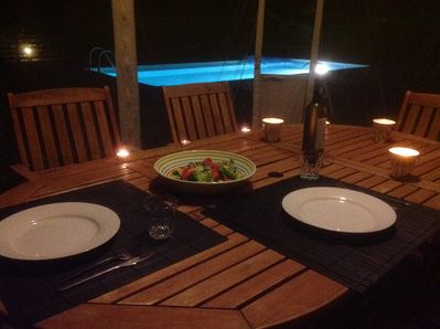 Romantice evening meal by the pool