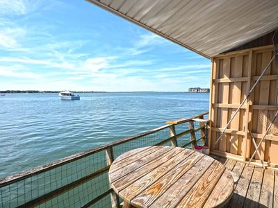 Photo for Upscale, relaxing 1 bedroom bayfront condo with free WiFi, a smart TV, and a pier directly over the bay located downtown and just a few blocks from the beach!