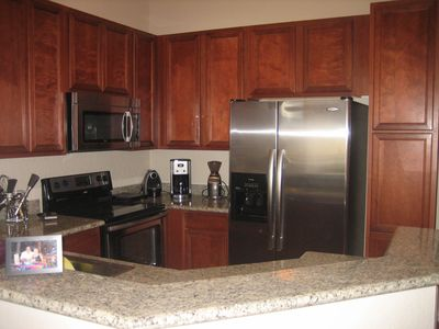 Kitchen with stainless steel appliances and granite counters.