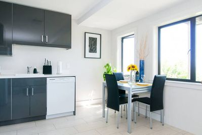 Recently remodeled modern kitchen, dining room.