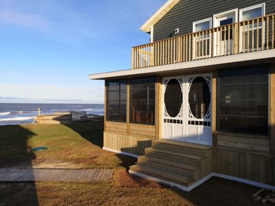 Photo for Three Bedroom Home With NEW Screened In Porch Only Steps Away From North Shore Beach