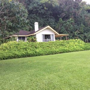 Punana Aloha faces the ocean on a half acre of lushly landcaped grounds
