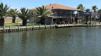 Photo for Delightful 3 bedroom canal property - with boat stall - Stingaree Landing