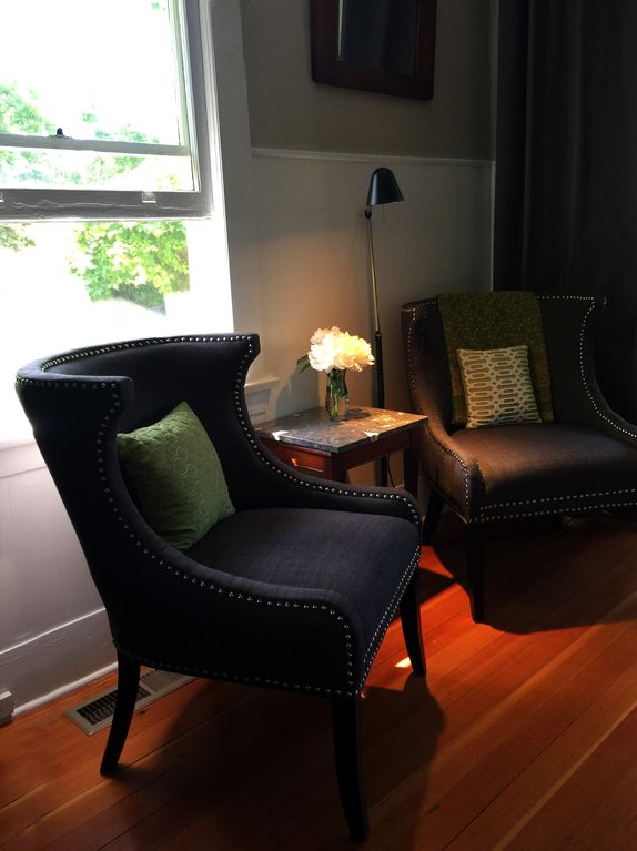 Two Oversized Chairs And Great Reading Light Offer A Comfortable Sitting  Area.