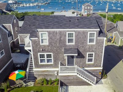 Photo for Stunning harbor view cottage, steps to downtown