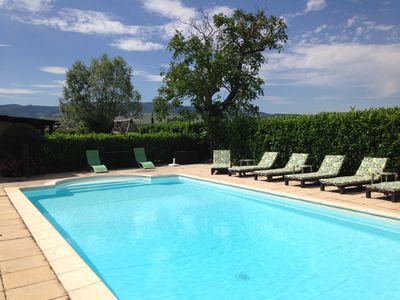 Heated pool sheltered by laurel hedge