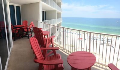Your amazing balcony with awesome view . There are eight chairs, one dining tabl