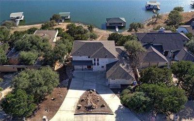 Photo for Luxurious Lake Travis Home w/ private kid friendly beach and boat dock