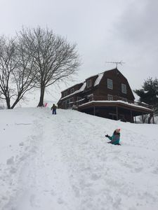 The house is surrounded by amazing sledding hills (sleds included!)