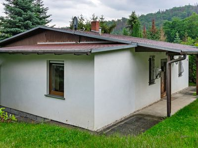 Photo for Stylish holiday home in the Harz, forest setting terrace fireplace garden detached