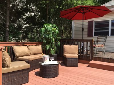 Private deck, outdoor dining area and gas grill