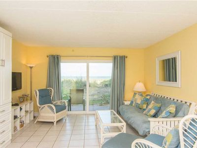 Family Room with a View - Enjoy sitting on the couch and playing a game of cards or watching the waves crash on the beach. Book Four Winds I-10E Down today!