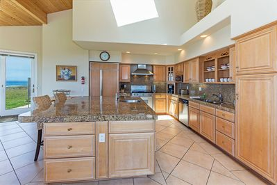Modern kitchen with granite counters and stainless steel appliances